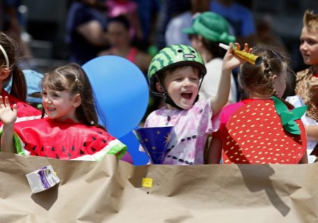 JASON HUNTER n WATERTOWN DAILY TIMES Olivia Sommerstein, left and Miles Attemann, wave from the Nature's Storehouse float Saturday during the annual Dairy Princess Festival Parade in downtown Canton.